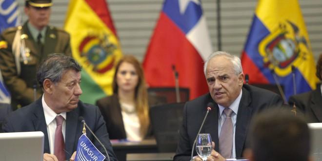 Uruguay's Foreign Minister Rodolfo Nin Novoa listens to UNASUR's Secretary-General Ernesto Samper during a meeting at the UNASUR headquarters in Quito