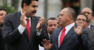 National Assembly President Diosdado Cabello, right, speaks with Vice-President Nicolas Maduro after a session by lawmakers at the National Assembly in Caracas, Venezuela, Saturday, Jan. 5, 2013. Allies of President Hugo Chavez on Saturday chose to keep Diosdado as National Assembly president who is the next in line to step in as a caretaker leader in some circumstances. Just five days remain until Chavez's scheduled inauguration on Thursday, and government officials are suggesting the swearing-in could be delayed as the president fights a severe respiratory infection after cancer surgery in Cuba. (AP Photo/Fernando Llano)