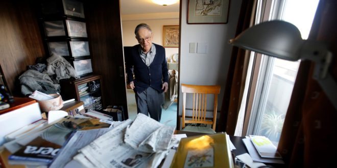In this Monday, Dec. 28, 2015 photo, Donald Keene enters his study at his home in Tokyo. Keene persevered, arriving in the ancient Japanese imperial capital of Kyoto in 1953 to do research. From those beginnings he counts about 25 books in English and 30 in Japanese and more than six decades of teaching. He's considered a giant in the field he helped build, translation and Japanese literature. His life has become so intertwined with Japan that he has decided to spend his remaining years here, becoming a Japanese citizen in 2012. (AP Photo/Shizuo Kambayashi)